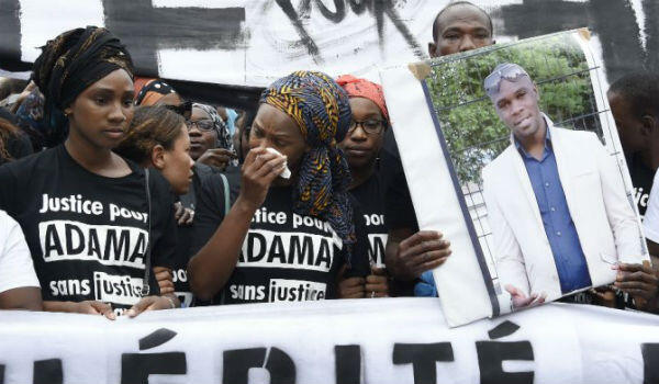Protesters march in Paris on November 5, 2016, seeking justice for Adama Traoré.