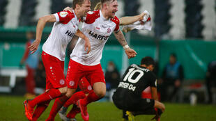 Essen players celebrate their shock German Cup win over Bayer Leverkusen in the last 16
