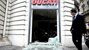 Two stores near the Champs-Elysees in Paris were looted, including a motorcycle shop where people took helmets, gloves and even bikes