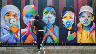 "Brazilian muralist Kobra's most recent work ""Coexistence"" represents five children from five of the world's major religions"