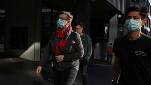 People wearing masks walk through the city centre as the state of New South Wales continues to report low numbers for new daily cases of the coronavirus disease (COVID-19), in Sydney, Australia, August 28, 2020.