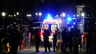 An ambulance arrives during a clash with Turkish special force on March 31, 2015 in Istanbul at the courthouse where a Turkish prosecutor was taken hostage