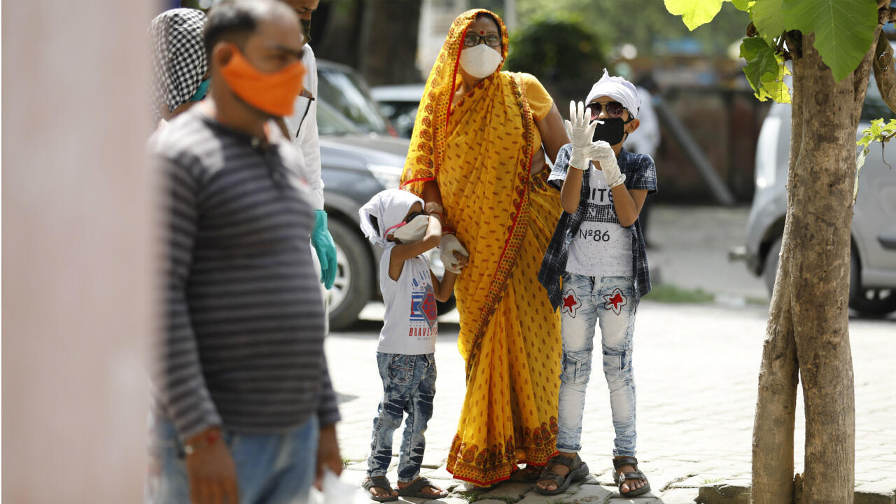 People wait in a queue to provide their nasal swab samples to test for Covid-19 in Prayagraj, India, on September 5, 2020.