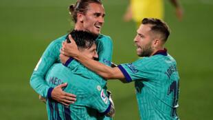 Antoine Griezmann celebrates with Lionel Messi after scoring a sensational chip against Villarreal on Sunday.