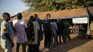 People line up to vote in Burkina Faso's presidential and legislative elections in Ouagadougou on November 22, 2020.