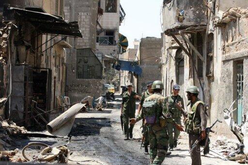Les combats ont laissé les rues de Damas dévastées
