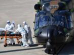 En France, évacuations de patients du coronavirus et contrôles routiers se poursuivent