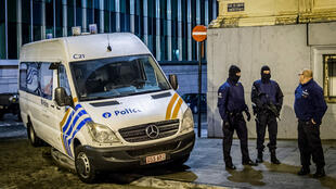 Forensics police at work in Verviers, eastern Belgium, on January 15, 2015, where two men were killed during an anti-terrorist operation.