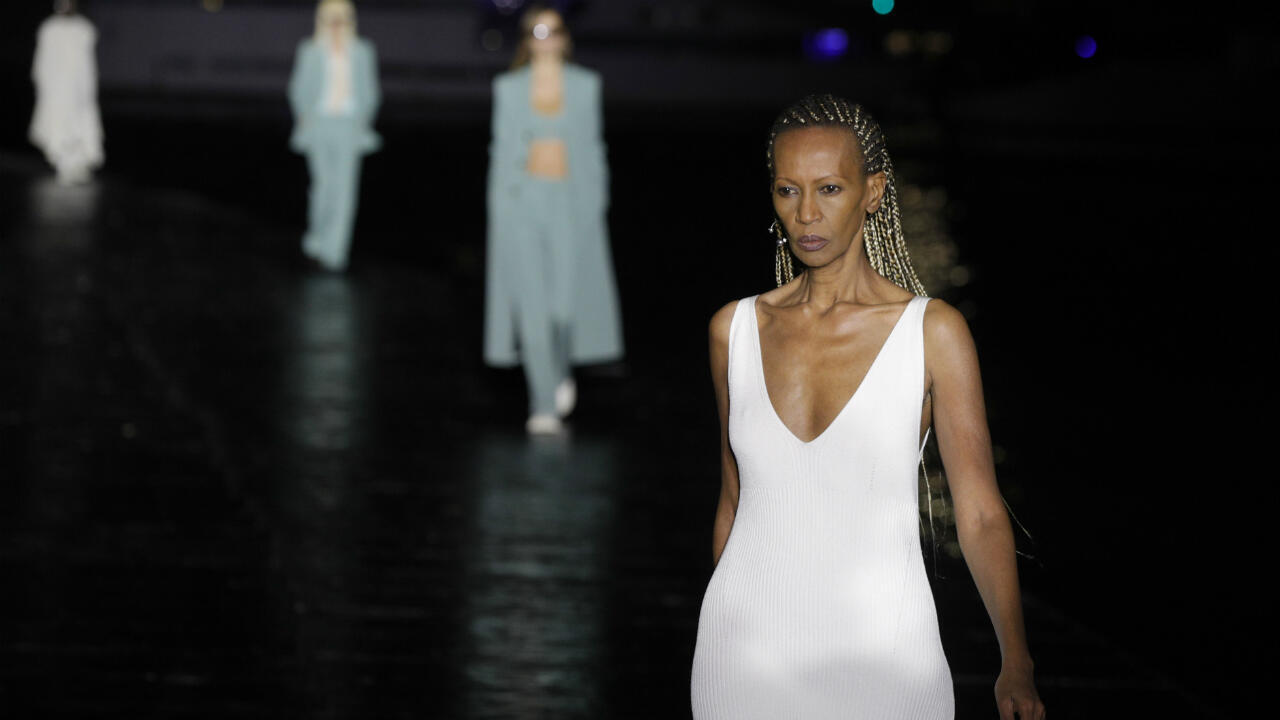 A model presents a creation for AMI by Alexandre Mattiussi during the women's Spring/Summer 2021 collection fashion shows in Paris on October 3, 2020.