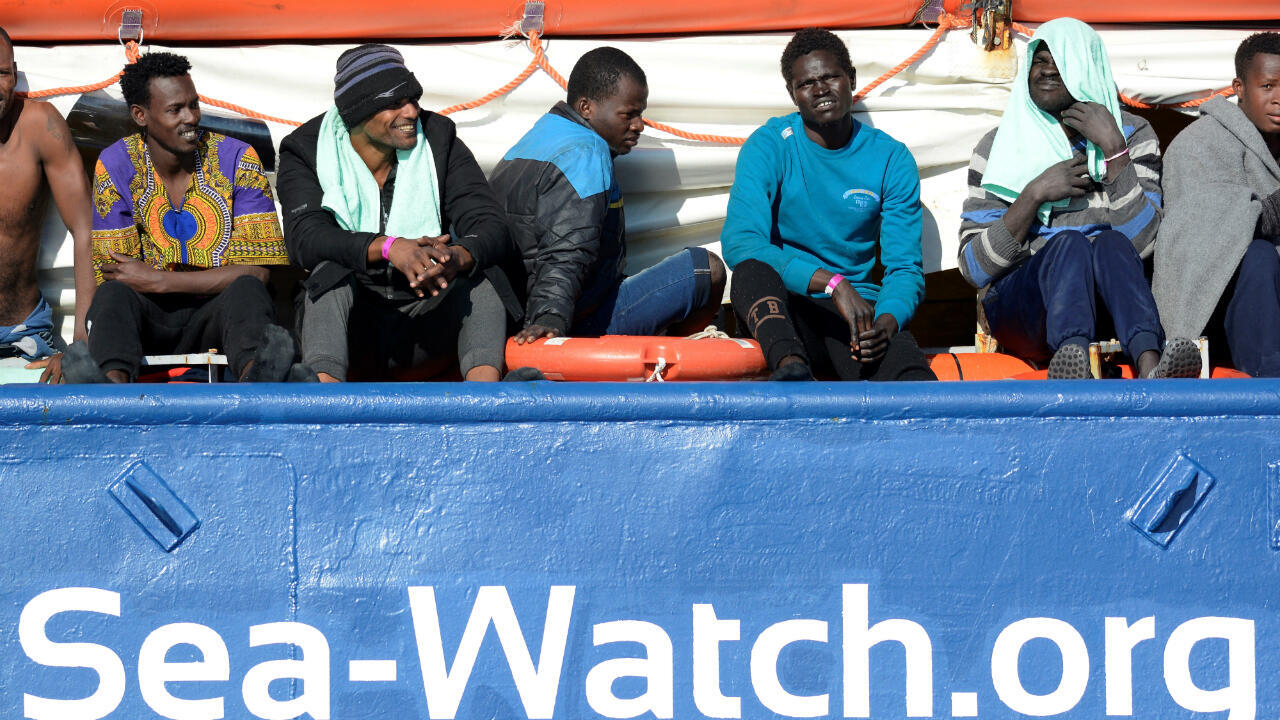 Migrants abaord the German rescue boat the Sea Watch arrive at Syracuse, Italy, on January 27, 2019.