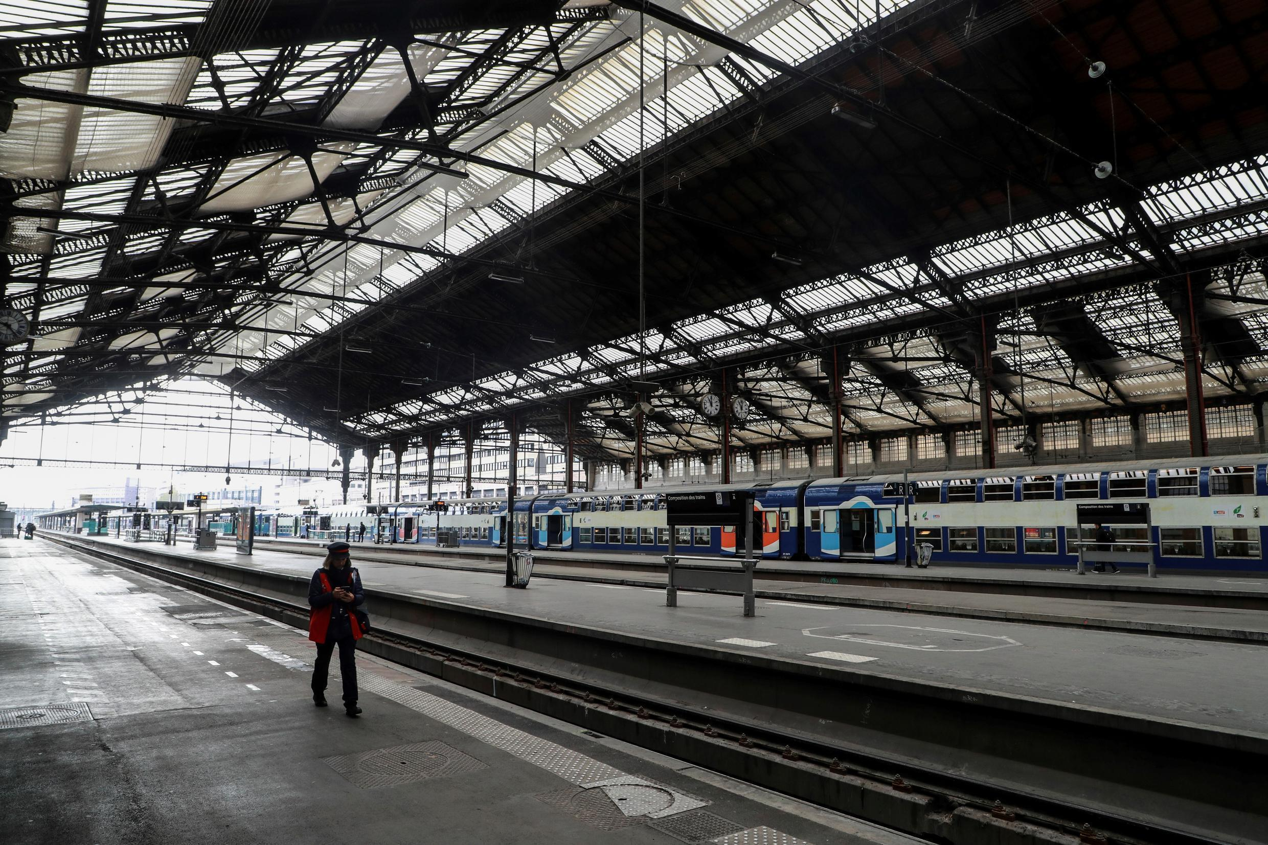 A SNCF employee walks on an empty platform of the Gare de Lyon train station in Paris on April 3, 2020 on the eighteenth day of a lockdown in France aimed at curbing the spread of the COVID-19 infection caused by the novel coronavirus in France.