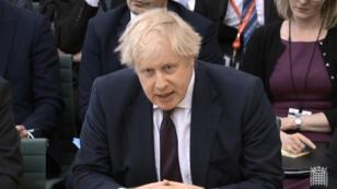 Boris Johnson devant le Parlement britannique, mercredi 21 mars à Londres.