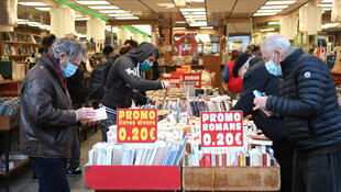 Customers look for books at Boulinier book shop in Paris on November 28, 2020, after the French government eased Covid-19 lockdown measures and allowed all 'non-essential' shops to re-open.