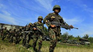 Des soldats philippins, le 1er mars 2016, à Butig Town, sur l'île de Mindanao.
