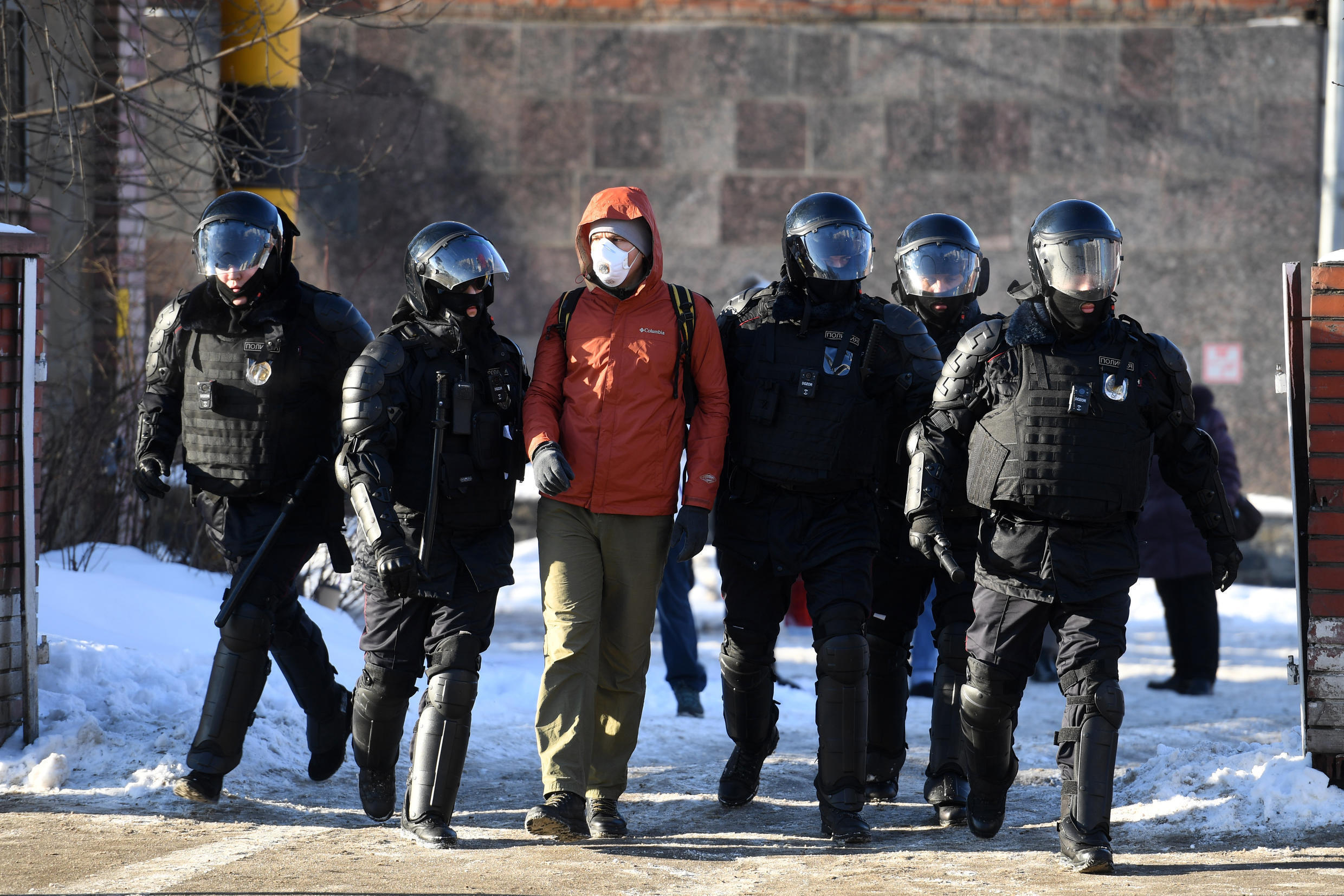 Russian police officers detain a man near the Moscow City Court where opposition leader Alexei Navalny was tried and sentenced on Tuesday, February 2, 2021