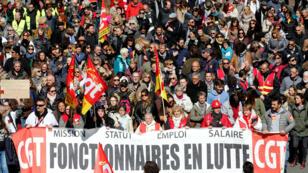 Manifestantes se movilizan durante el día de huelga nacional contra las reformas de Emmanuel Macron en Marsella, el 22 de marzo de 2018.