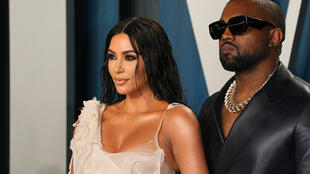 US realty TV star Kim Kardashian (L) and husband US rapper Kanye West attend the 2020 Vanity Fair Oscar Party in February 2020