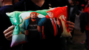 A Trump supporter holds a pillow of him and Kanye West at the US president's campaign rally in Las Vegas, Nevada, on February 21, 2020.