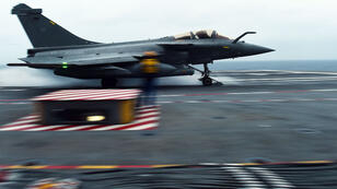 A French Rafale fighter aircraft is catapulted off aircraft carrier Charles-de-Gaulle off the coast of Toulon, southern France, on January 16, 2015