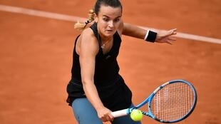 France's Clara Burel returns the ball to Slovenia's Kaja Juvan during their women's singles second round tennis match on Day 5 of the French Open tennis tournament in Paris on October 1, 2020.