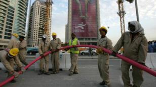 Des travailleurs au Qatar en 2006