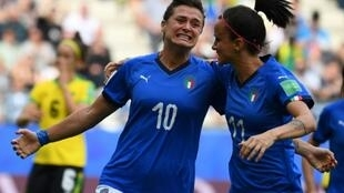 Cristiana Girelli (L) is congratulated by fellow Italy and Juventus teammate Barbara Bonansea after her hat-trick against Jamaica