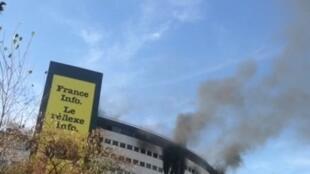 Smoke rises from the Maison de la Radio in Paris's affluent 16th district