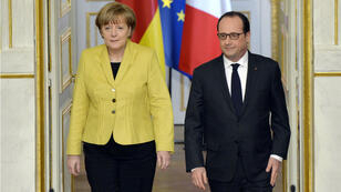 German chancellor Angela Merkel and French President François Hollande called on all sides to respect the Ukraine ceasefire in a joint press conference in Paris Friday