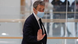 Nicolas Sarkozy leaves after an interruption in his trial on charges of corruption and influence peddling, at Paris courthouse, France, November 23, 2020.
