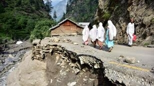 Only a few damaged homes remain after flooding in Laswa Valley, near the Line of Control in Pakistan-administered Kashmir