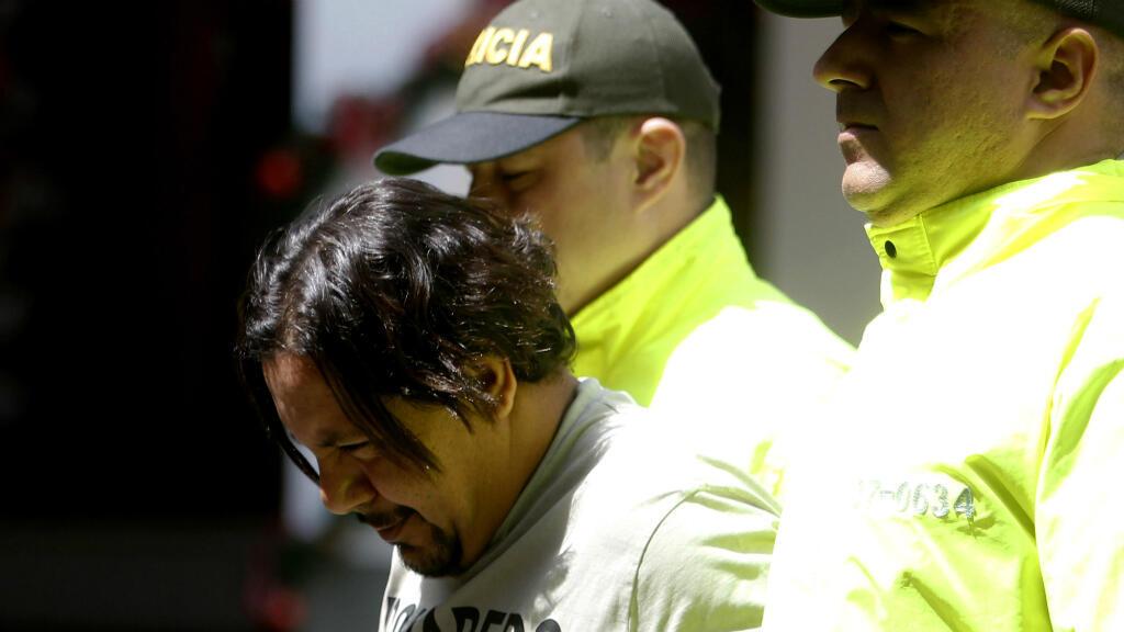 """La policía de Colombia entrega a Juan Carlos Mesa, alias """"Tom"""", Medellín, 9 de diciembre de 2017."""