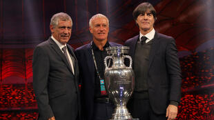 From left, Portugal coach Fernando Santos, France coach Didier Deschamps and Germany coach Joachim Loew pose with the trophy after being drawn in group F in the Euro 2020 Finals Draw in Bucharest, Romania, on November 30, 2019.