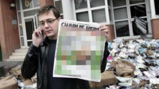 """Une photo publiée par le """"New York Daily News"""" sur laquelle la caricature de """"Charlie Hebdo"""" a été pixélisée"""