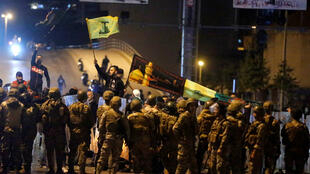Supporters of Hezbollah and Amal face off with Lebanese soldiers in Beirut on November 25, 2019.