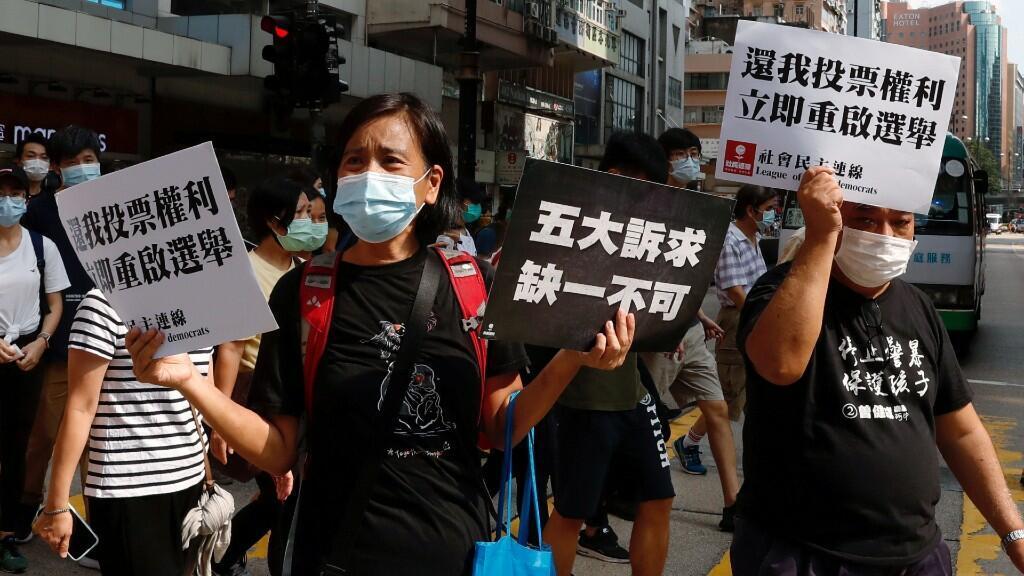 Manifestantes prodemocracia marchan durante una manifestación en contra de las elecciones aplazadas, en Hong Kong, China, el 6 de septiembre de 2020
