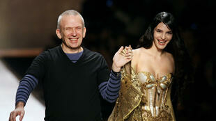 French designer Jean Paul Gaultier acknowledges the audience at the end of his Spring/Summer 2008 Haute Couture collection show in Paris on January 23, 2008.