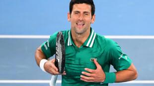 Serbia's Novak Djokovic celebrates beating France's Jeremy Chardy