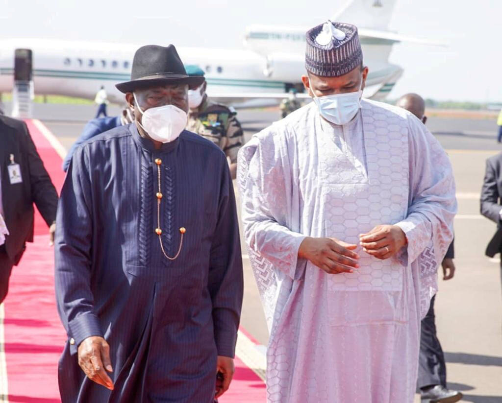 Mali's Prime Minister Boubou Cisse greets former Nigerian president and Mali crisis mediator Goodluck Jonathan upon his arrival in Bamako on July 23, 2020.