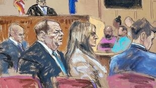 A courtroom sketch of Harvey Weinstein and his lawyer Donna Rotunno listening as Judge James Burke instructs the jury to keep deliberating.