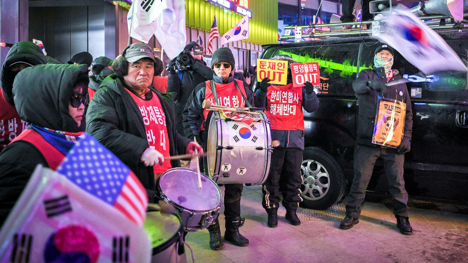 But the symbolic rapprochement between the two Koreas has provoked some discontent, with protesters gathering outside the stadium.