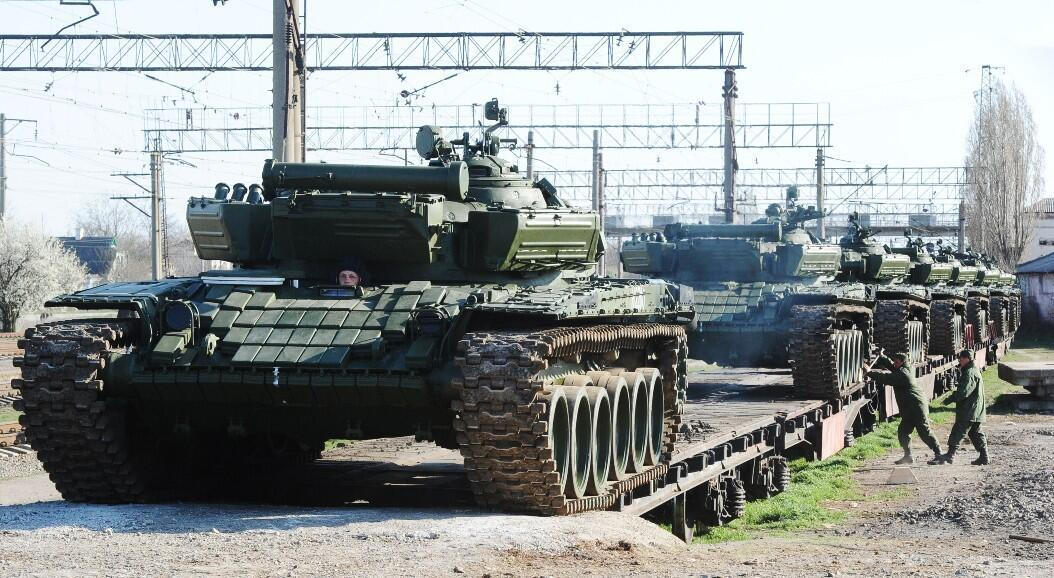 FILE - Russian soldiers unload a train of their modified T-72 tanks after it arrives at the Gvardeyskoe train station, near the Crimean capital Simferopol, on March 31, 2014.