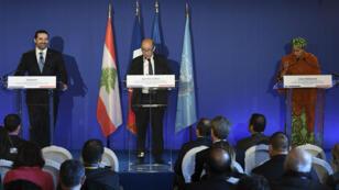 Le Premier ministre libanais Saad Hariri, le chef de la diplomatie française Jean-Yves Le Drian, et la secrétaire générale adjointe de l'ONU, Amina Mohammed, à Paris, le 8 décembre 2017.