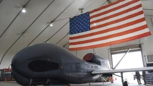 In this image released by the US Air Force, an RQ-4 Global Hawk drone sits in a hangar at Al Dhafra Air Base, United Arab Emirates