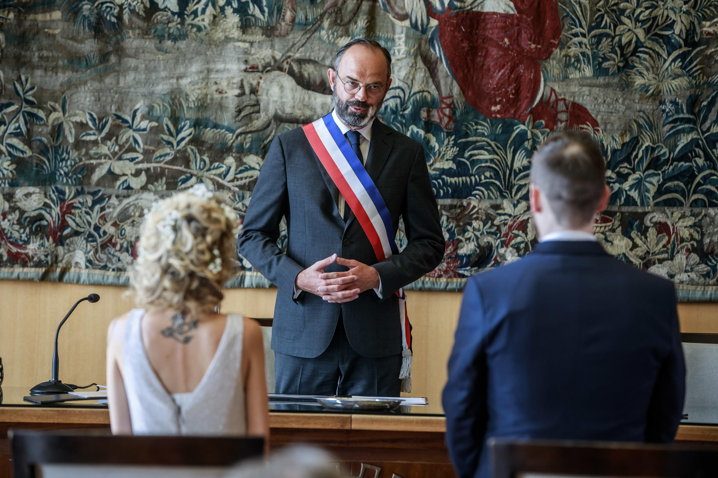 French Prime Minister and candidate for Le Havre city hall Edouard Philippe (C) celebrates a wedding in Le Havre, Normandy, on June 20, 2020, during a campaign visit ahead of the second round of France's municipal elections to be held on 28 June 2020.