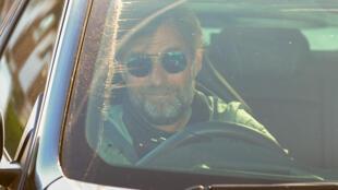 Back to work: Jurgen Klopp arrives at Liverpool's training ground on Wednesday