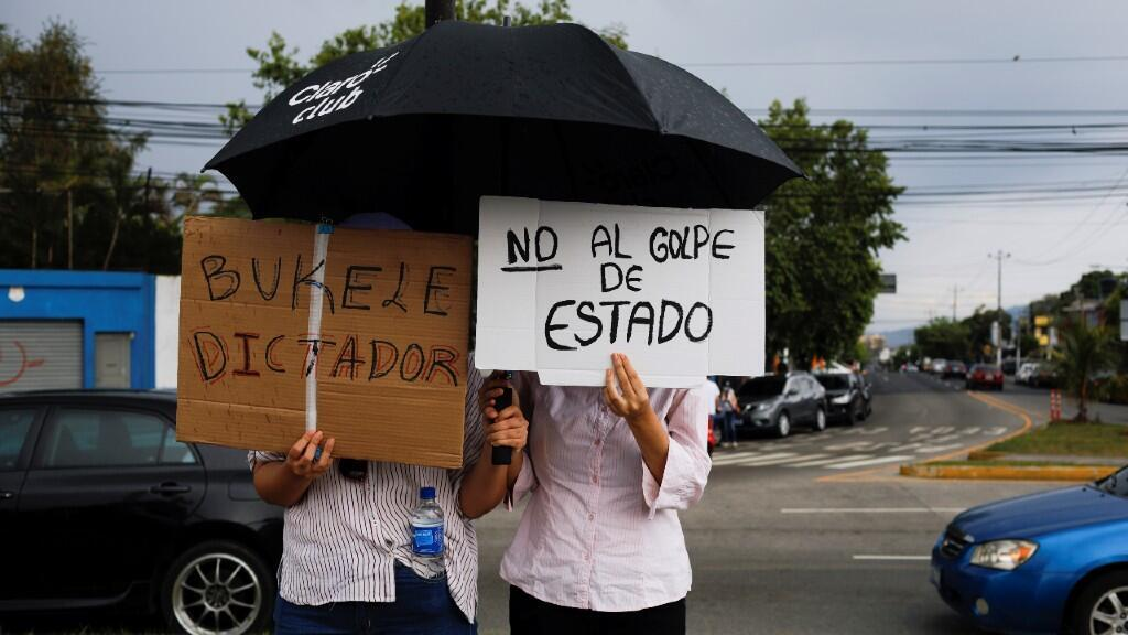 "People hold signs that say ""Respect for the Constitution"", while protesting against the dismissal of the Supreme Court judges and the Attorney General by the Salvadoran Congress, in San Salvador, El Salvador, on May 2, 2021."