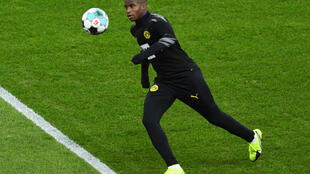 Youssoufa Moukoko warms up before making his Borussia Dortmund debut on Saturday