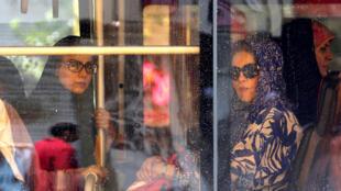 Iranian women riding a bus in Tehran.