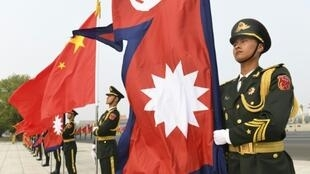 Chinese members of a guard of honour hold Nepalese and Chinese flags ahead of a welcoming ceremony for Nepal's President Bidhya Devi Bhandar at the Great Hall of the People in Beijing on April 29, 2019