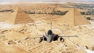 A Rafale fighter jet, manufactured by Dassault Aviation, flies over the desert in Egypt on December 23, 2014.